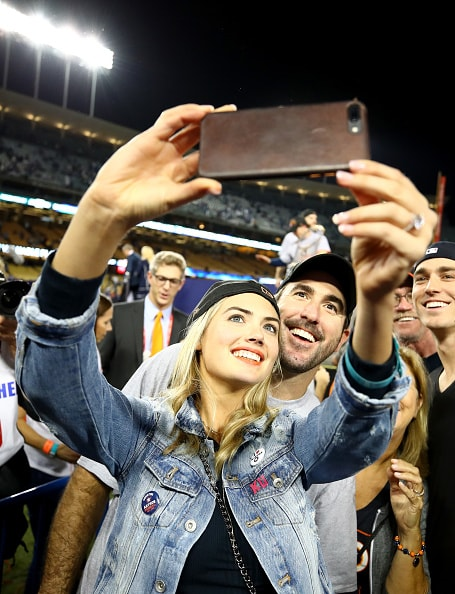 LOS ANGELES, CA - NOVEMBER 01:  Justin Verlander #35 of the Houston Astros takes a picture with fiancee Kate Upton after the Astros defeated the Los Angeles Dodgers 5-1 in game seven to win the 2017 World Series at Dodger Stadium on November 1, 2017 in Los Angeles, California.  (Photo by Ezra Shaw/Getty Images)