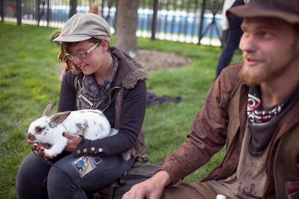 CHICAGO, IL - JULY 03:  Mahrin Owings and Dylan Howard, who rode a freight train to the concert, waits with Grateful Dead fans for the gates of Soldier Field to open for one of the band's final shows on their 50th anniversary tour on July 3, 2015 in Chicago, Illinois. The show is one of three scheduled to be held in Chicago this weekend to mark the end of the band's 50 years together.  (Photo by Scott Olson/Getty Images)