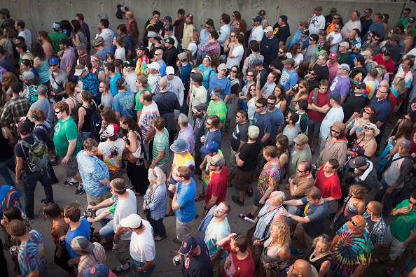CHICAGO, IL - JULY 03:  Grateful Dead fans wait for the gates of Soldier Field to open for one of the band's final shows on their 50th anniversary tour on July 3, 2015 in Chicago, Illinois. The show is one of three scheduled to be held in Chicago this weekend to mark the end of the band's 50 years together.  (Photo by Scott Olson/Getty Images)